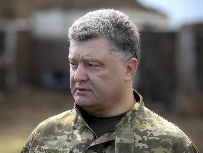 Порошенко настаивает на новых санкциях против РФ, если перемирие на Донбассе будет сорвано
